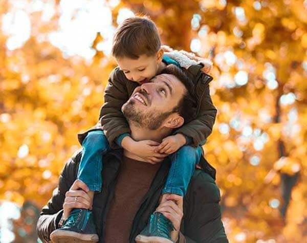 Father and son enjoying fall